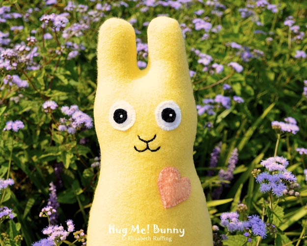 Soft yellow fleece Hug Me Bunny Rabbit by Elizabeth Ruffing, with lavender ageratum