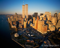 Aerial view of  Lower Manhattan, Battery Park, New York City, New York, USA (Jake Rajs) Tags: park city nyc newyorkcity sunset usa ny newyork history nature ecology horizontal publicspace clouds outdoors photography us scenery day commerce unitedstates dusk manhattan unitedstatesofamerica worldtradecenter shoreline citylife aerialview nopeople historic business batterypark photograph land northamerica environment twintowers hudsonriver capitalism enterprise distance past majestic trade environmentalism thepast worldfinancialcenter lowermanhattan goldenhour finance ecosystem midatlantic newyorkharbor traveldestinations colorimage financing mercantilism timeofday historicphotograph