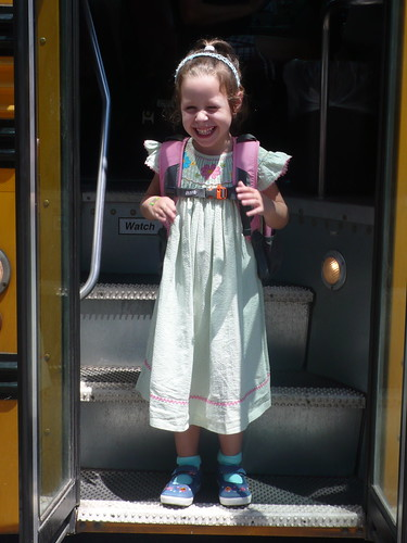 Daisy getting off the bus after her 1st day of Pre-School