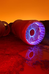 Muddy red spiropipe (- Hob -) Tags: longexposure blue red orange lightpainting mud led nophotoshop spirograph cathode concretepipe sooc hypotrochoid lightjunkies
