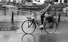 Wet feet (Iam sterdam.) Tags: holland rain amsterdam bike bicycle spiegelgracht womanonabike