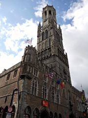 Big, bold Belfry, Bruges. (davidezartz) Tags: blue windows light red sky orange brown white signs black building green clock sunshine yellow architecture clouds grey big nikon europe shadows belgium belgique brugge flags medieval east belfry bruges turret soe leans bold belfort autofocus metre wow1 icapture s4000 prominent 1240 thegalaxy bej nikonstunninggallery mywinners 47bells citrit 366steps flickrestrellas quarzoespecial rubyphotographer kunstplatzlinternational platinumbestshot however~itssti
