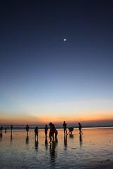 Sunset Kuta (M_usett_A) Tags: ocean sunset sky bali fish seascape clouds indonesia bay fisherman sand market indonesian kuta