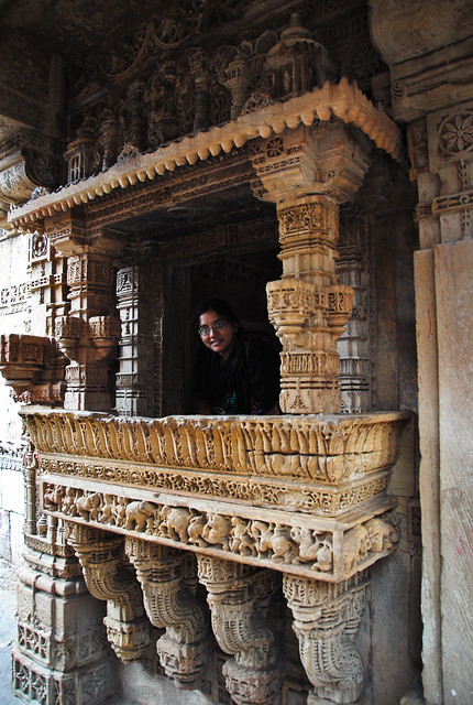 Ekta at the Carved window