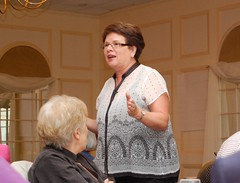 Author Bea McGarvey speaks to a crowd during a meeting of all Department of Education staff.