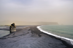 Black sand (RomImage) Tags: ocean sea mer mist seascape black beach water yellow rock misty fog dark landscape iceland nikon europe tide north foggy atlantic shore seashore plage bord brume islande maree matin colorphotoaward d700