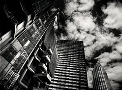there goes the neighbourhood #2 (mugley) Tags: city sky urban blackandwhite bw reflection 120 mamiya film lines architecture modern clouds rollei buildings mediumformat prime construction 645 scaffolding cityscape glare shadows lift skyscrapers geometry towers grain perspective angles australia melbourne wideangle victoria scan lookup negative balconies epson cbd 6x45 r3 cloudporn mamiya645 rmit urbanlandscape redfilter kishokurokawa corners polariser 25a v700 cloudage keystoning stewartst mamiya645protl melbournecentraltower m645 rolleir3 alimak prestonbins 35mmf35sekorn abecketttower swanstonacademicbuilding