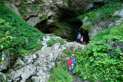 Beneath the castle the Lovka stream runs into the cave (Bn) Tags: castle history geotagged countryside high jackie rocks tunnel chapel dungeon flags medieval cliffs tournament slovenia chan cave grad visitor karst region fortress renaissance castel baron hideout robber 1420 postojna burcht grot predjama lueg hhlenburg predjamski erazem geo:lat=45815879 culturalandhistoricalheritage lueghi gradpredjama notranjskakarst 1000uploadsopdedoka geo:lon=14127055 predjama1 knightsofadelsberg