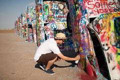 Cadillac Ranch Graffiti (Juha Helosuo) Tags: road ranch summer portrait people hot art digital america writing canon painting photography graffiti route66 texas desert buried f14 mother sigma 66 spray cadillac legendary route amarillo the 30mm sigma30mmf14exdchsm 50d