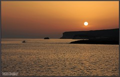 Tramonto Cala Croce (Lampedusa) (DiegoGuidone) Tags: pictures desktop light sunset italy art beach colors canon landscape geotagged eos photo nice barca italia tramonto mare foto picture sigma diego playa natura belle wallpapers fotografia roccia per azzurro colori spiaggia dei cala conigli croce isola lampedusa sfondo sfondi tema photografy scoglio photocard 18250 550d guidone