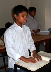 Md. Ashadul Huq reading Braille