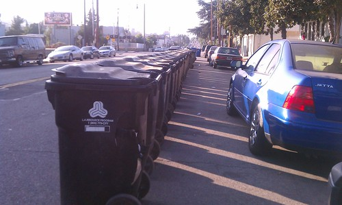 Trash cans blocking the street at Avenue 50 and North Figueroa Street in Highland Park