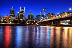 Portland Skyline at Blue Hour (Brandon Godfrey) Tags: city light urban usa water colors skyline night oregon america reflections portland photography us twilight construction scenery colorful downtown cityscape colours crane or unitedstatesofamerica towers scenic scene clear hawthornebridge highrise pacificnorthwest northamerica pdx bluehour colourful bridgetown willametteriver hdr highdynamicrange highrises cityskyline koincenter rosecity eastbankesplanade cityofroses wellsfargotower multnomahcounty pacwestcenter portlandfederalbuilding