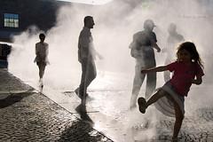 Raindance (Alex Guerra) Tags: street light shadow people woman mist colour reflection portugal window water girl backlight dance play stones lisboa lisbon smoke silhouettes cobbled spray