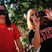 Students gathered to watch and photograph a hot-wing eating contest.