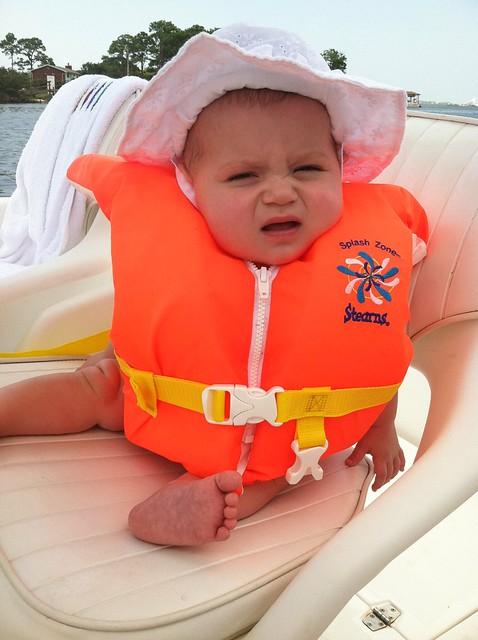 Emory wears a life vest