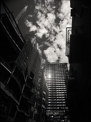 there goes the neighbourhood (mugley) Tags: city sky urban blackandwhite bw sun reflection 120 mamiya film lines architecture modern clouds rollei buildings mediumformat prime construction 645 scaffolding cityscape glare shadows crane geometry perspective angles australia melbourne wideangle victoria scan lookup negative balconies epson cbd 6x45 r3 cloudporn mamiya645 rmit urbanlandscape redfilter corners sab polariser 25a v700 cloudage keystoning stewartst mamiya645protl m645 rolleir3 35mmf35sekorn abecketttower swanstonacademicbuilding