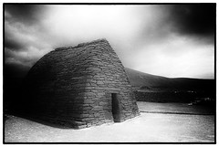 Gallarus Oratory, Dingle Peninsula, Ireland, Europe, black and white (jackie weisberg) Tags: ireland blackandwhite bw horizontal stone architecture ancient europe stones huts hut stonewalls beehive dinglepeninsula stonehut gallarusoratory beehivehut ninthcentury platinumheartaward nikonflickraward jackieweisberg doublyniceshot doubleniceshot tripleniceshot flickawardgallery flickerawards5 galleryoffantasticshots flickrstruereflection1 flickrstruereflection2