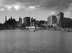 Liverpool Skyline (Tony Worrall Foto) Tags: uk england building wet water weather architecture liverpool skyscape landscape photo northwest image grim stock scenic stormy scenary tall feature albertdock merseyside hoizon 2011tonyworrall