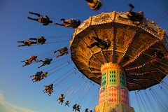 Swingy things -- sunset ride (Rozanne Hakala) Tags: carnival sunset summer sky people motion colors fun outdoors movement md ride swings maryland fair amusementpark rotation midway gaithersburg countryfair waveswinger montgomerycounty 2011 montgomerycountyfair mcaf