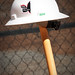 A stickered hard hat sits atop a shovel after the Talley groundbreaking ceremony.