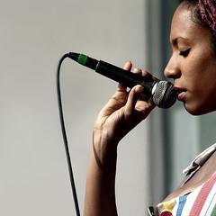 """on stage"" (helmet13) Tags: portrait musician music woman concert raw hand performance simplicity vocalist microphone studies selectivefocus peaceaward heartaward d300s africafestival2011"
