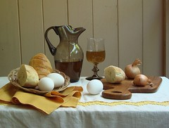 The Bread Of Life. (Esther Spektor - Thanks for 6 millions views..) Tags: light stilllife brown white reflection art glass wall bread table pattern basket wine artistic embroidery napkin egg creative explore onion tablecloth 1001nights bodegon cuttingboard naturemorte goblet naturamorta artisticphotos bej stunningphotogpin