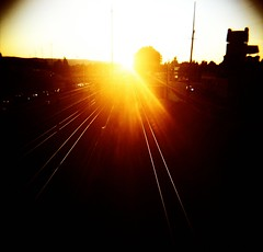 PDX Sunset (liquidnight) Tags: road sunset sky sunlight film oregon analog mediumformat portland evening xpro crossprocessed kodak horizon traintracks tracks diana rails pdx analogue dianaf vignetting ektachrome i84 e100g