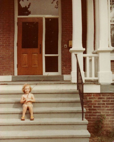 pantsless in front of a house