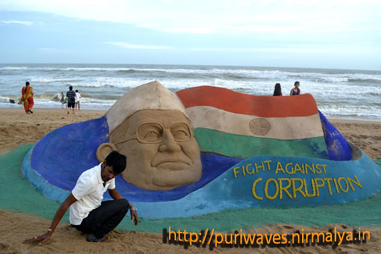 Sand sculpture of Anna with  a message Fight against corruption