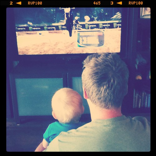 Uh oh! He's liking and watching dirt biking with Daddy!