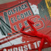 Wolfpack Welcome Week sign hangs from Withers Student Center as a dancing inflatable man grooves to the tunes at the Back to School Jam on Harris Field.