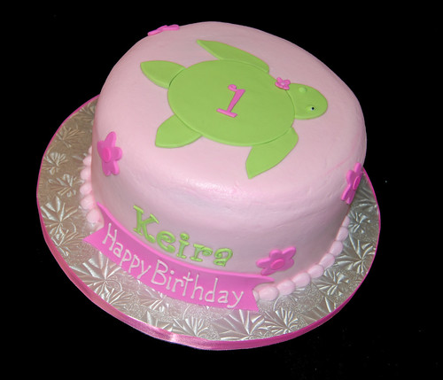 1st birthday pink and green sea turtle Hawaiian cake