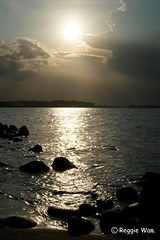Sun setting at Punggol. (Reggie Wan) Tags: sunset seascape silhouette singapore asia southeastasia punggol rockybeach punggolbeach reggiewan sonya850 sonyalpha850 gettyimagessingaporeq1