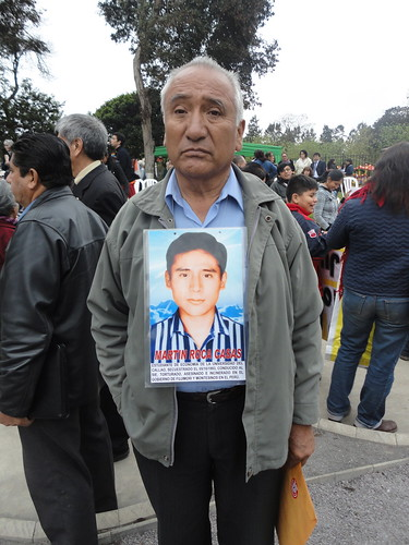 Javier Roca wearing a photo of his disappeared son Martin Roca
