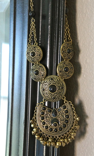 Black and gold pendant necklace