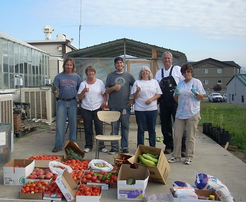 Members of the Wenatchee Lab's People's Garden team—Sid Tate, volunteer; Debbie Larson, volunteer; Taylor Millican, volunteer; Anne Conway, employee; Charles Carmody, employee; and Devi Davis, volunteer—proudly showcase produce harvested from the garden on August 12, 2011. The produce pictured here was donated to Wenatchee's Veteran's Stand-Down, an event where community members reach out to veterans in need and their families. (U.S. Forest Service, PNW Research Station)