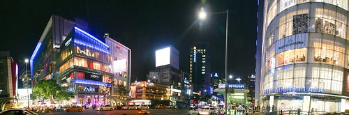 A panoramic night photo of the Myeongdong shopping district in the heart of Seoul.