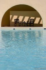 CONVERSACIONES DE VERANO (ngel mateo) Tags: espaa water pool andaluca spain agua shadows chairs arc piscina andalusia arco sombras almera cabodegata sillas ngelmartnmateo ngelmateo