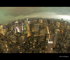 Storm over New York City ! (yopse - Arnaud Montagard) Tags: city nyc newyorkcity roof usa ny newyork storm weather skyline night america canon buildings cityscape view cloudy centralpark manhattan fisheye uptown empire empirestatebuilding nocturne 15mm orage tempte densit urbaine immeubles 50d yopse arnaudmontagard