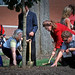 Members of the NC State community takes turns in planting a commemorative tree on the Brickyard during a memorial service following the 9/11 attacks.