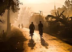 Biking to market (samthe8th) Tags: morning sunlight bicycle silhouette early cool market burma biking myanmar inlelake uncool fm nyaungshwe cool2 cool5 cool3 cool6 cool4 matchpointwinner cool9 d700 flickrchallengewinner cool7 cool8 iceboxcool thepinnaclehof kanchenjungachallengewinner tphofweek114