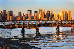 Manhattan Glow (SunnyDazzled) Tags: park city nyc bridge sunset sun newyork skyline liberty harbor glow cityscape skyscrapers manhattan