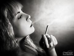 Smoking Dark (Oscar.vng) Tags: light portrait blancoynegro luz girl canon dark chica retrato smoke cigar smoking fumar humo cigarro blachwhite 400d oscarvng ancoradesig