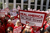 Nurses rally again to ask that Wall Street be taxed