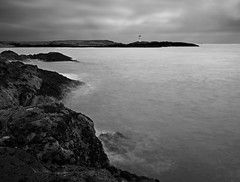 JAGGED EDGE (kenny barker) Tags: uk longexposure sea bw lighthouse seascape monochrome landscape grey coast scotland rocks mood fife atmosphere panasonic g1 elie coastuk fleursetpaysages
