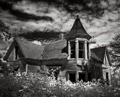the Whispering House in summer (Rodney Harvey) Tags: blackandwhite tower abandoned architecture farmhouse rural decay ghost haunted creepy spooky oldhouse missouri infrared whispers turret