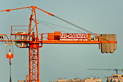 Tal-Mag (jonblack) Tags: sky orange construction crane cables wires weights lifting concrette