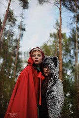 Red Riding Hood V (Alexander Kuzmin) Tags: wood red portrait haircut green girl fashion fairytale forest hair scary couple wolf alone dress darkness availablelight innocent riding short stare hood cloak gaze glance redridinghood alexanderkuzmin kuzmin