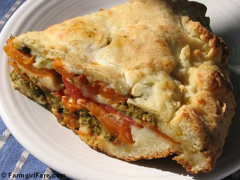 Savory tomato, mozzarella, and basil pesto pie with an easy cheesy biscuit crust